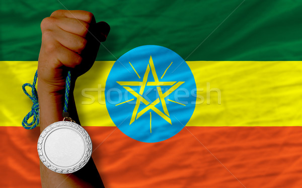 Silver medal for sport and  national flag of ethiopia    Stock photo © vepar5