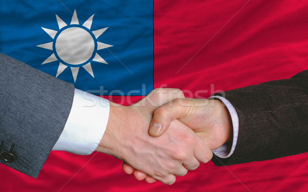 Işadamları el sıkışma iyi anlaşma Tayvan bayrak Stok fotoğraf © vepar5