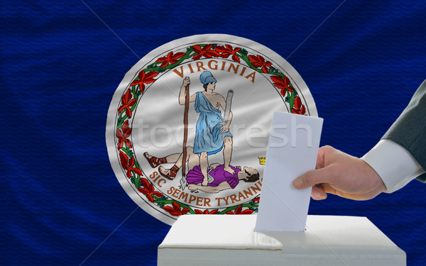 man voting on elections in front of flag US state flag of virgin Stock photo © vepar5