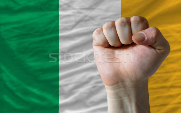 Hard fist in front of ireland flag symbolizing power Stock photo © vepar5