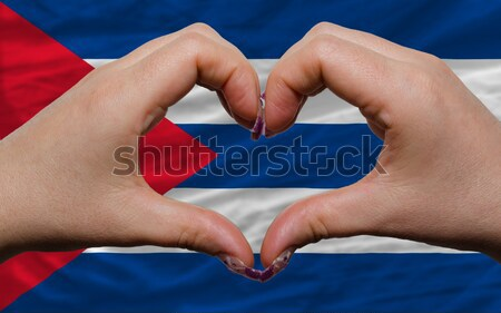 Heart and love gesture showed by hands over flag of cuba backgro Stock photo © vepar5
