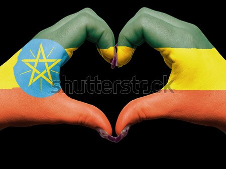 Heart and love gesture showed by hands over flag of ethiopia bac Stock photo © vepar5