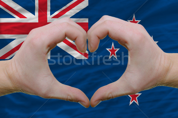 Heart and love gesture showed by hands over flag of new zealand  Stock photo © vepar5