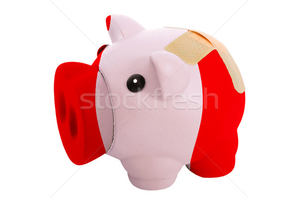 closed piggy rich bank with bandage in colors national flag of p Stock photo © vepar5