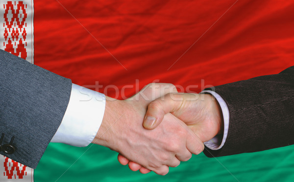 businessmen handshakeafter good deal in front of belarus flag Stock photo © vepar5