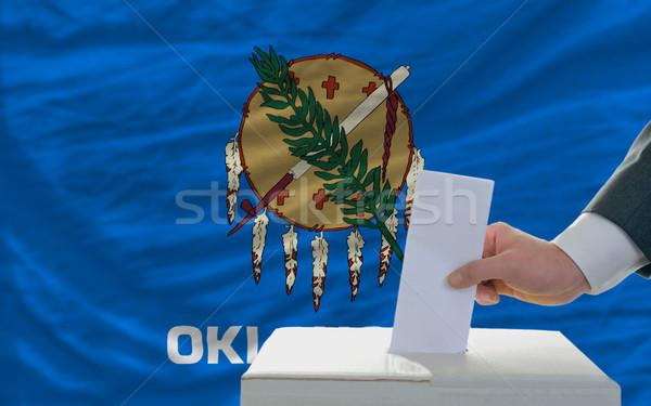 Homem votação eleições bandeira cédula caixa Foto stock © vepar5