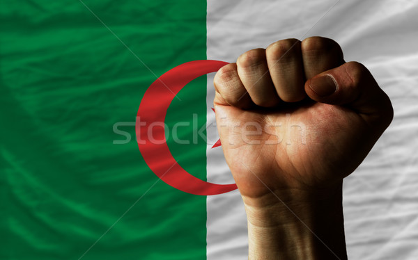 Hard fist in front of algeria flag symbolizing power Stock photo © vepar5