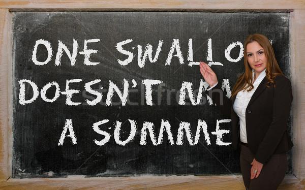 Teacher showing One swallow doesn't make a summer on blackboard Stock photo © vepar5