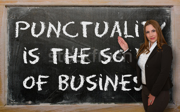 Teacher showing Punctuality is the soul of business on blackboar Stock photo © vepar5
