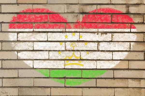 heart shape flag of tajikistan on brick wall Stock photo © vepar5