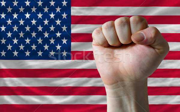 american national flag with hard fist in front of it symbolizing Stock photo © vepar5