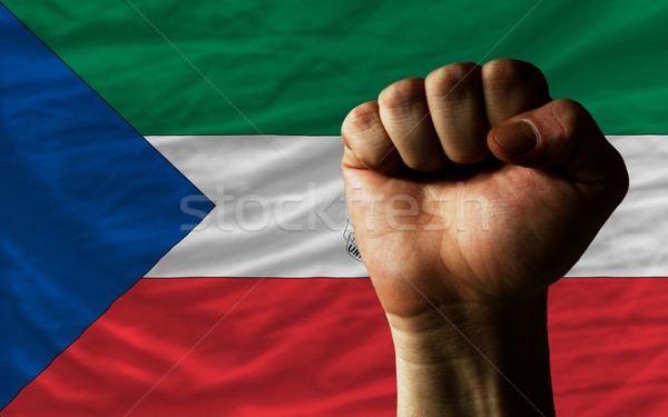Hard fist in front of equatiorial guinea flag symbolizing power Stock photo © vepar5