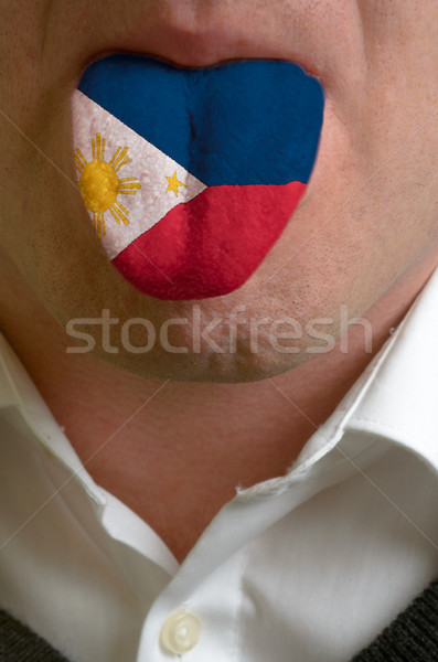man tongue painted in philippines flag symbolizing to knowledge  Stock photo © vepar5