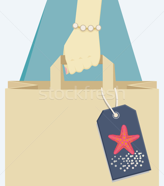 Paper bag tagged with a starfish, symbol of summer Stock photo © veralub