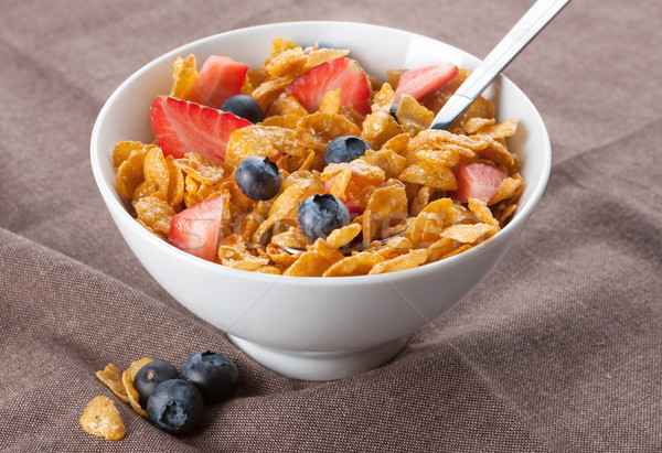 Stock photo: Bowl of corn flakes and berries