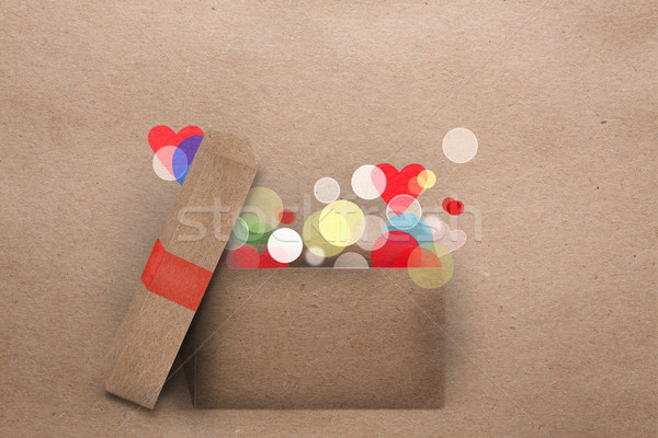 Open cardboard box with colorful lights Stock photo © veralub