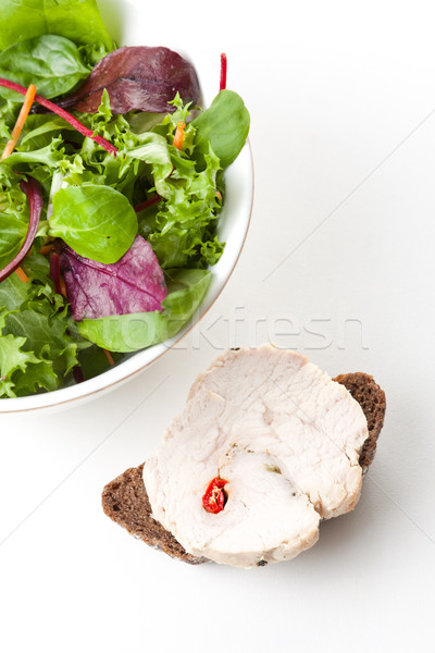 Fresh tossed green salad and bread Stock photo © veralub