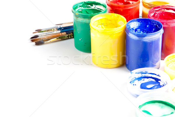 Jars of brightly coloured paint with brushes Stock photo © veralub