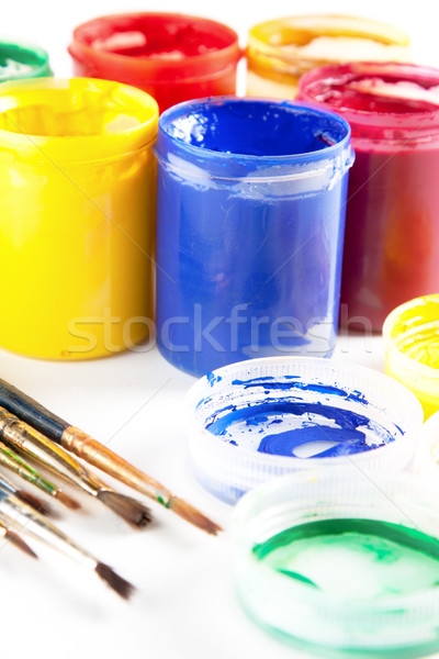Colourful paints and paintbrushes Stock photo © veralub