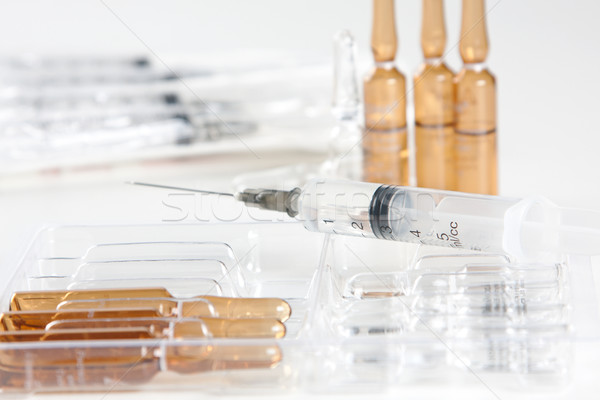 Close-up shot of syringe and vials Stock photo © veralub
