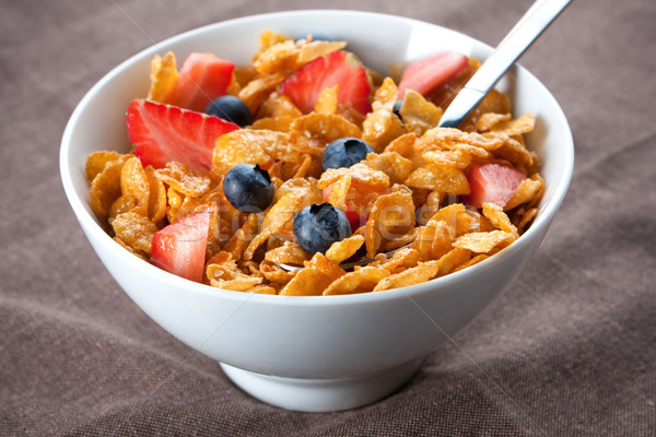 Bowl of corn flakes and berries Stock photo © veralub