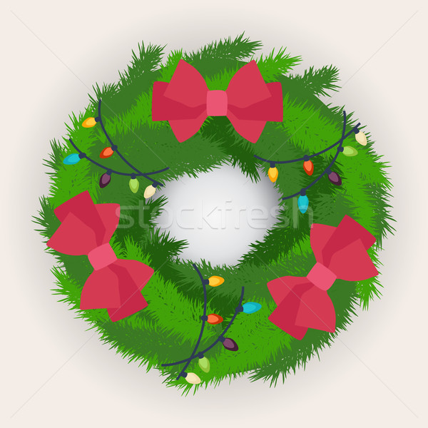 Christmas wreath decorated with red bows Stock photo © veralub