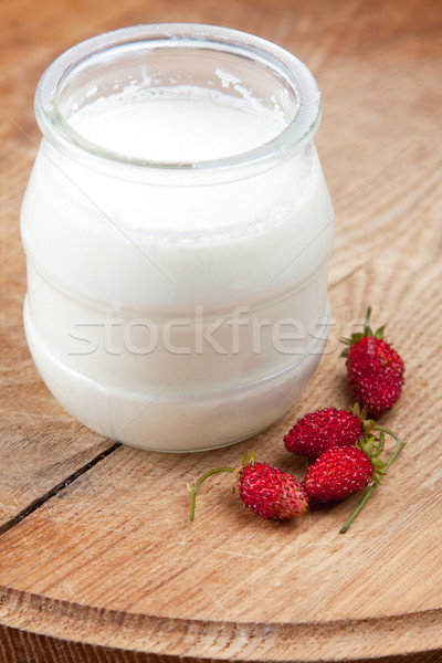 Natural yoghurt in a glass pot Stock photo © veralub
