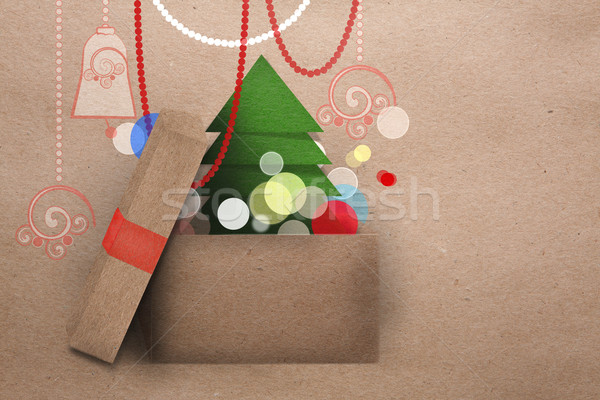 Open cardboard box with Christmas tree Stock photo © veralub