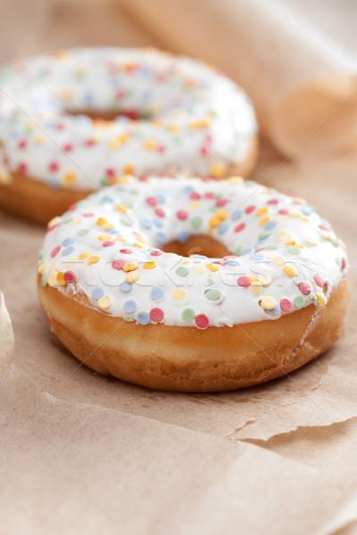Fresh glazed doughnut with sprinkles Stock photo © veralub