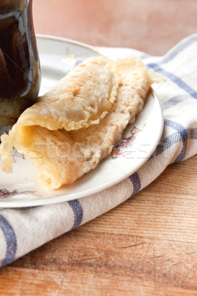 Rolled batter pancake with filling Stock photo © veralub