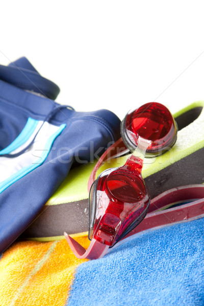 Swimming trunks, goggles and towel Stock photo © veralub