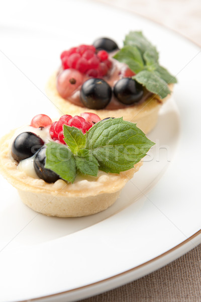 Indiviual freshly baked fruit tartlets Stock photo © veralub