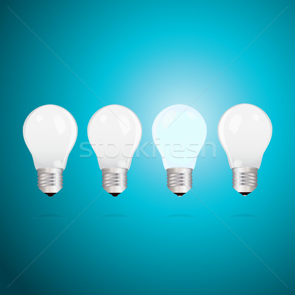 Idea concept with light bulbs on a blue background Stock photo © veralub