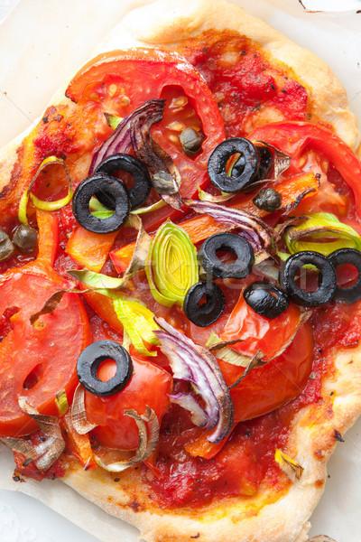 Delicious homemade crusty pizza Stock photo © veralub