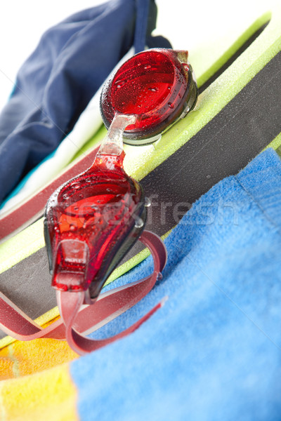Colourful beach towel and swimming goggles Stock photo © veralub