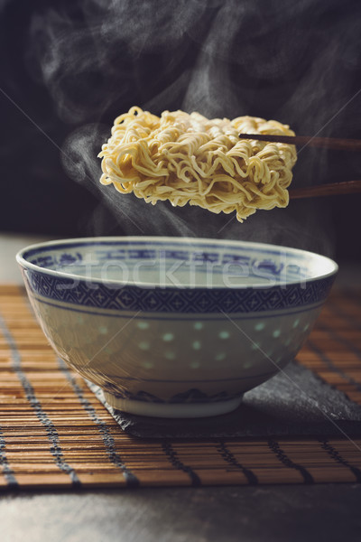 Asian Instant noodles over a traditional bowl. Stock photo © vertmedia