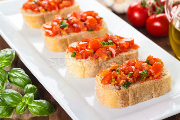 Bruschetta paradicsomok friss felszolgált tányér étel Stock fotó © vertmedia