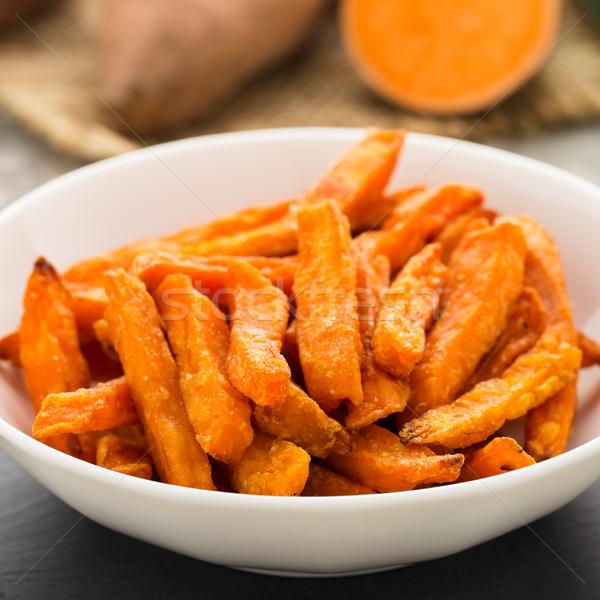 Zoete aardappel frietjes geserveerd kom vet witte Stockfoto © vertmedia