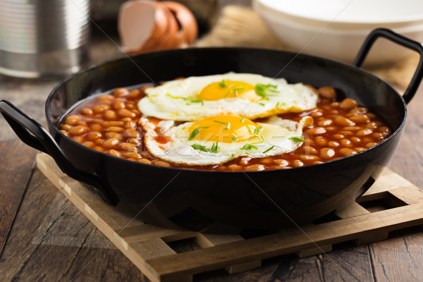 Baked Beans with fried eggs and chives Stock photo © vertmedia