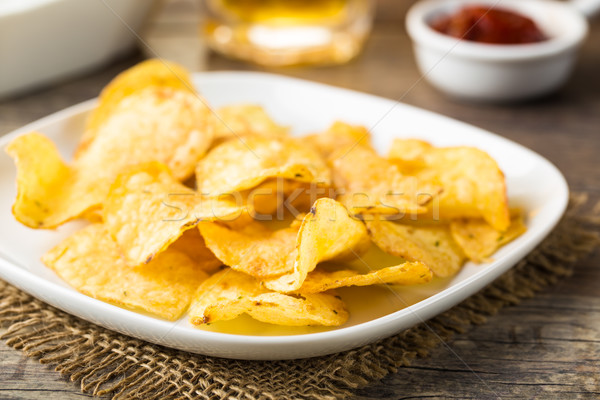 Hearty potato chips served on a plate Stock photo © vertmedia