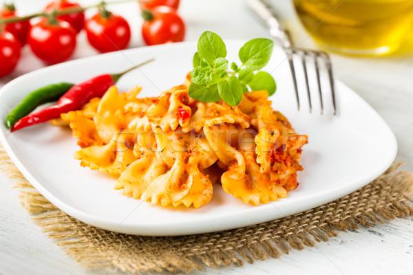 Farfalle arrabiata - bow-tie pasta with hot tomato sauce Stock photo © vertmedia