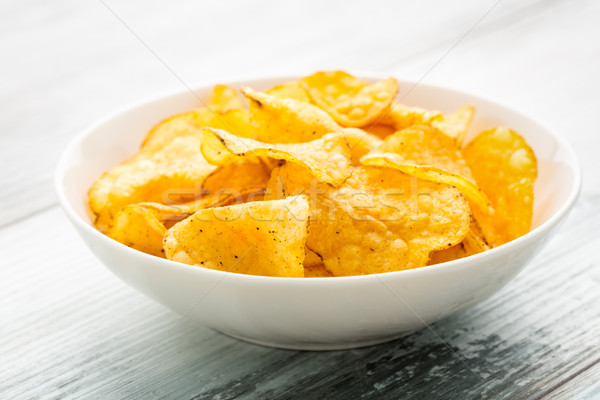 Hearty potato chips in a bowl Stock photo © vertmedia
