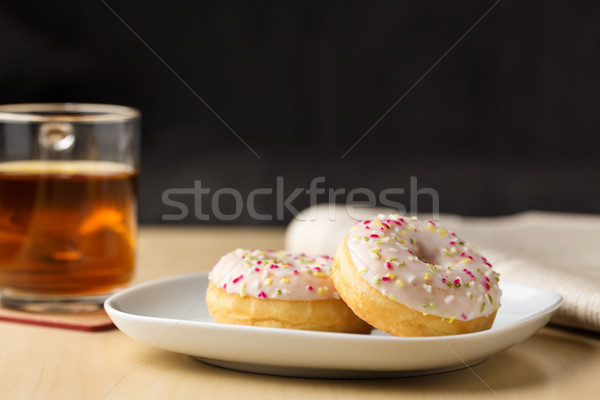 donut with sprinkles and tea Stock photo © vertmedia