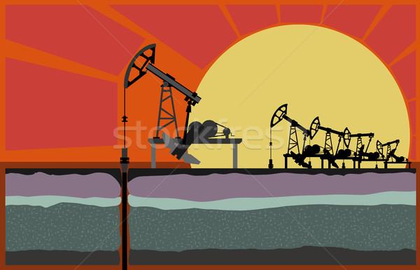 Oil pump machins against sunset. Stock photo © Vertyr