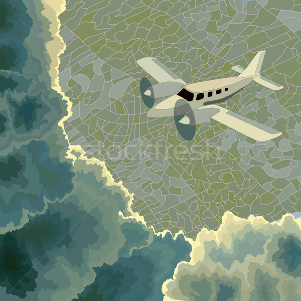 Private plane among clouds above ground. Stock photo © Vertyr