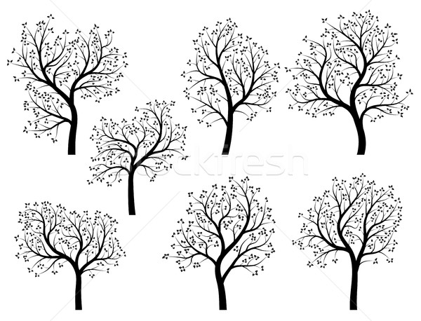 Abstract silhouettes of spring trees with leaves. Stock photo © Vertyr