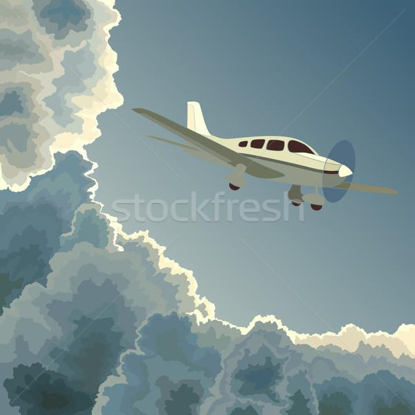 Private plane among clouds at dusk. Stock photo © Vertyr