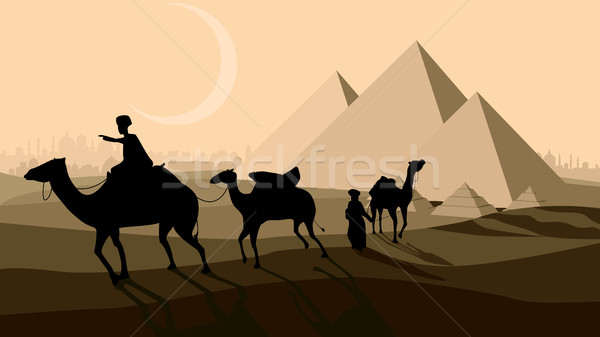 Vector bedouin caravan camels against over pyramids.  Stock photo © Vertyr
