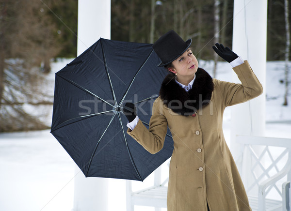 Woman with umbrella feeling winter wind flow Stock photo © vetdoctor