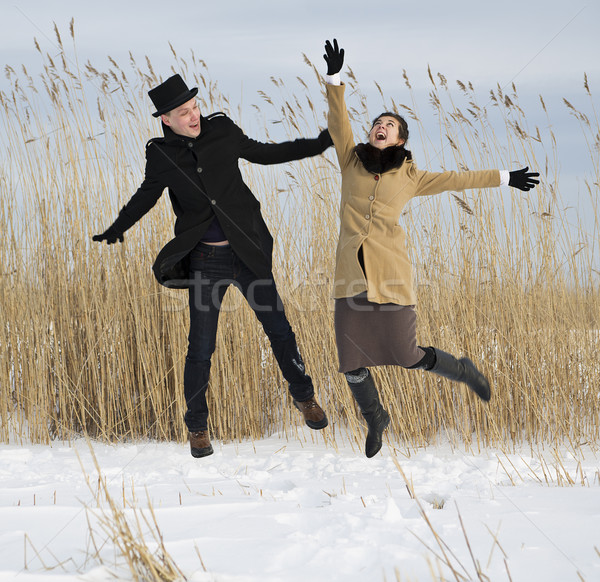 Man and woman jump on lake beach Stock photo © vetdoctor